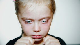 Child crying - a little girl crying against a white background. close up stock video footage