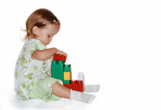 Child with cubes. Child playing with cube toys Royalty Free Stock Images