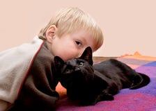 Child cuddles his cat. Stock Photo
