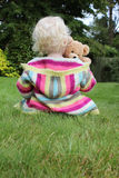 Child Cuddling Teddy Bear Stock Photography