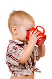 Child with a cup Stock Images