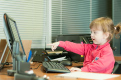 The child with curiosity points a finger in the co Stock Image