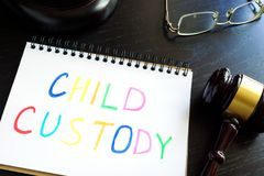 Child custody written in a note and gavel. Royalty Free Stock Photography