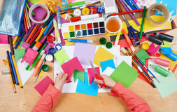 Child cut applique top view. Artwork workplace with creative accessories. Flat lay art tools for painting. Stock Photo