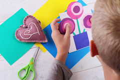 Child cut out of colored paper. Kid making  birthday card. Happy mothers day and happy 8 march. Kids Art, Art Projects, Handmade N Stock Photography