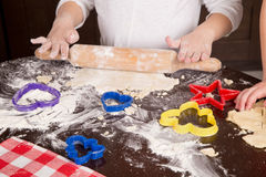 Child cut out cookies for baking Royalty Free Stock Photo
