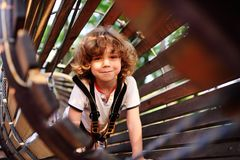 Cute curly child in a rope park Stock Photography