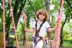 Cute curly child in a rope park Royalty Free Stock Photography