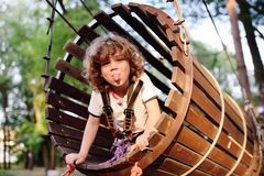 Cute curly child in a rope park Royalty Free Stock Photo