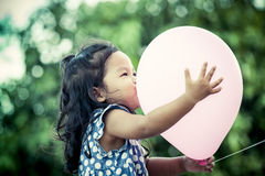 Child cute little girl having fun with pink balloon Stock Photography