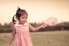 Child cute little girl having fun to play with her bubbles toy Stock Photos
