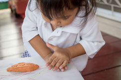 Child cute little girl playing with clay Royalty Free Stock Photos