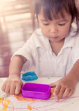 Child cute little girl playing with clay, play doh Stock Images