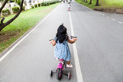Child cute little girl riding bike Royalty Free Stock Images