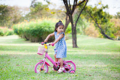 Child cute little girl riding bike Royalty Free Stock Image