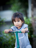 Child cute little girl riding on seesaw Stock Photo