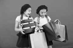Child cute small girls on shopping tour. Best price. Buy now. Visit shopping mall. Kids girls hold bunch shopping bags. Or birthday gifts packages. Dreams come royalty free stock photos