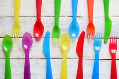 Child Cutlery On A White Wooden Table In A Kindergarten. Colorful Flatware Stock Images