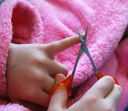 Child cuts nails stock images