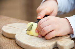Child cutting an apple Royalty Free Stock Photo