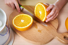 Child cutting knife orange Stock Photography