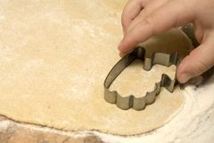 Child cutting out cookies Royalty Free Stock Photo
