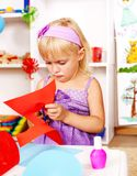 Child cutting out scissors paper. Royalty Free Stock Images