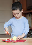 Child cutting paper Stock Images