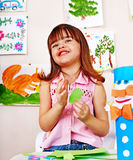 Child cutting paper by scissors. Royalty Free Stock Photography