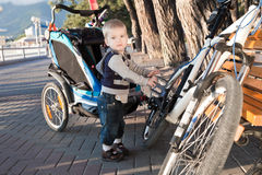 Child on cycling in  carriage Royalty Free Stock Photo
