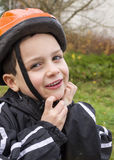 Child with cycling helmet Stock Images