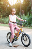 Child cycling outdoor. Royalty Free Stock Images