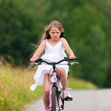 Child cycling outdoors in summer Royalty Free Stock Image
