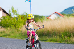 Child cycling outdoors in summer Stock Photo