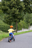 Child cycling on a path Royalty Free Stock Photo