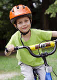 Child cyclist cycling. Child cyclist, portrait of a boy cycling on his children bike or bicycle Royalty Free Stock Image