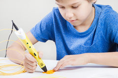 Child with 3d pen. Creative, technology, leisure, education concept. Schoolboy with 3d pen. Creative, leisure, technology education concept Stock Images