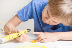Child with 3d pen. Creative, technology, leisure, education concept. Schoolboy with 3d pen. Creative, leisure, technology education concept Royalty Free Stock Images