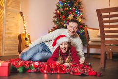 Smiling girl with dad near christmas tree at home Royalty Free Stock Photo
