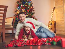 Smiling girl with dad near christmas tree at home royalty free stock image