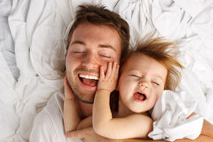 Child Dad White Sheet Laugh Lay Royalty Free Stock Images