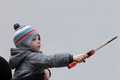 Child with a dagger toy Stock Photos