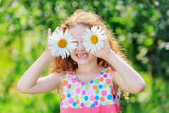 Child with daisy eyes, on green bokeh background Royalty Free Stock Photography