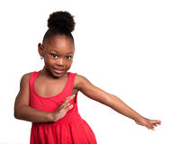 Child Dancer. Beautiful little girl wearing red dress dances Royalty Free Stock Photos