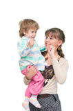 The child dances on hands at mum Stock Photography