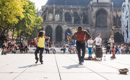 Child dances with street performer in Stravinsky Place, Paris, F Royalty Free Stock Image