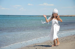Child dancing on the beach Royalty Free Stock Photos