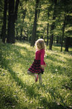Child dancing in forest Stock Photos