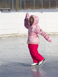 Child Dancing on Ice Skates Stock Images