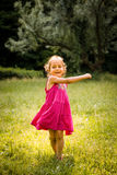 Child dancing in nature Stock Photos